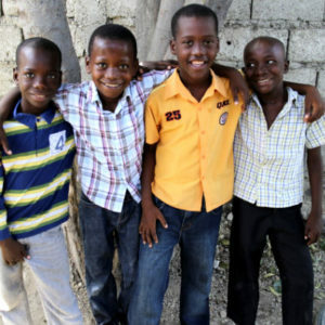How You Can Help - Four Young Boys Standing Together